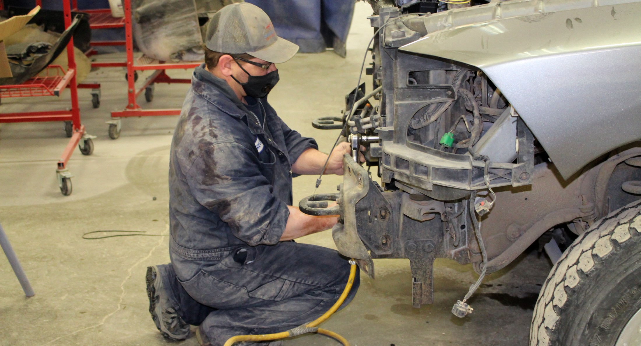 A bergens expert employee works on a vehicle in the autobody shop in regina